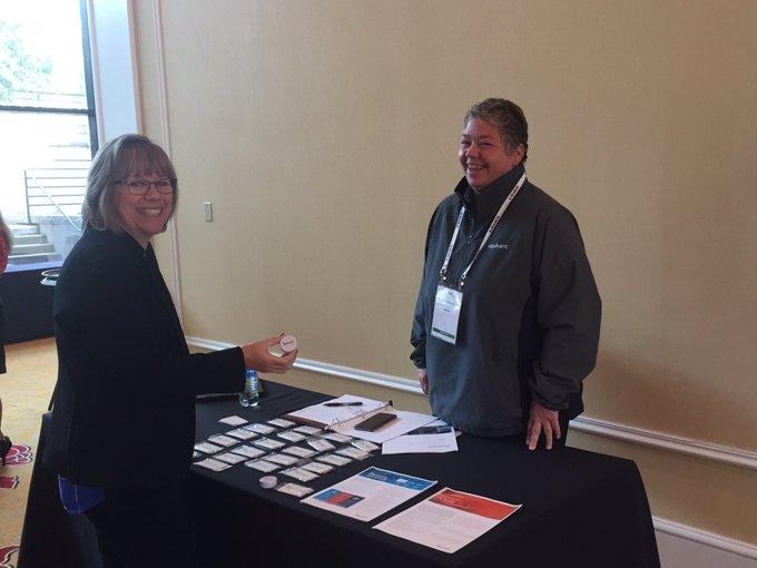 SEARCH Staff Diane Chin meets Gold Sponsor Katie Brachel of equivant.